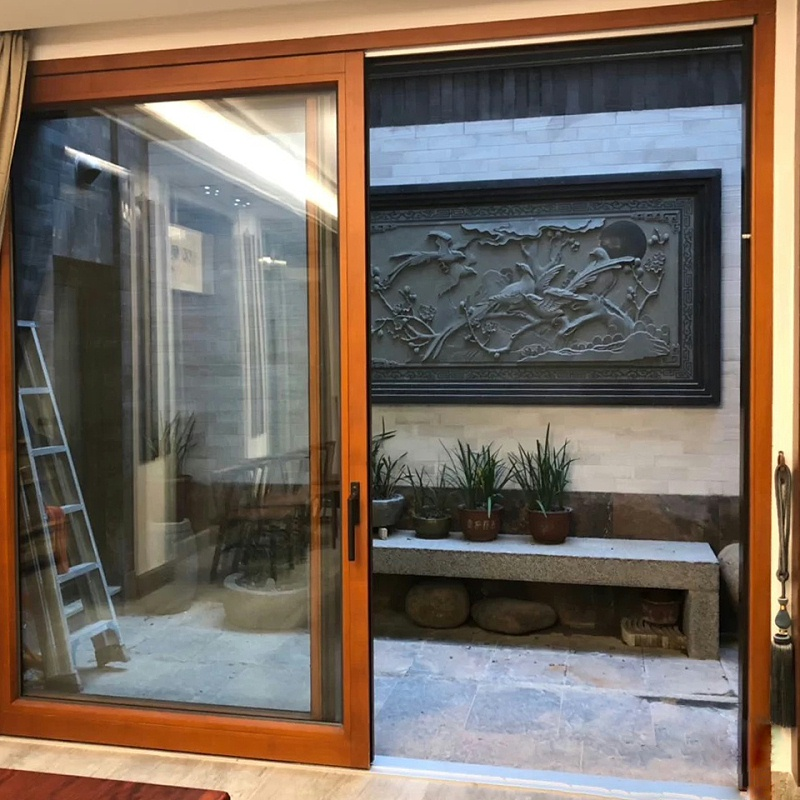 严严冬日里选择保暖的铝木复合门窗有多重要?