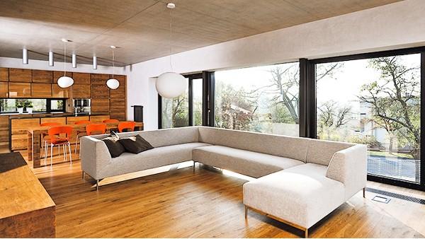 为什么现代建筑的外墙装饰门窗都采用高端铝合金门窗?